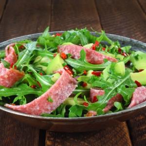 Salad with arugula, salami and avocado