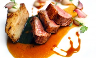 Lamb fillet with garlic, mint sauce and potato