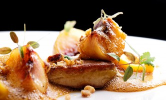 Haute cuisine, roasted Foie gras with homemade ravioli and apples