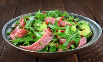 Salad with arugula, salami and avocado