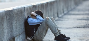 young homeless boy  crying on the bridge, poverty, city, street, negative emotion