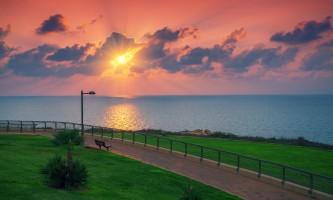 Sunset over sea. Embankment, Netanya city, Israel
