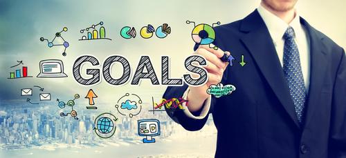 Businessman drawing Goals concept